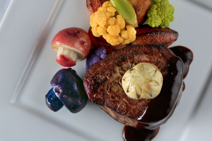 Chef cut filet steak paired with fluted mushrooms and a fig demi glaze