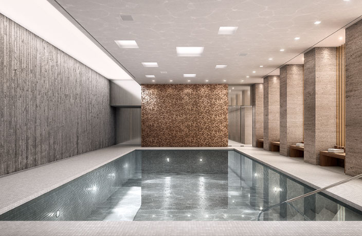 Luxurious, indoor heated pool detailed in ceramic mosaic tile and Roman Travertine marble with custom-made teak benches