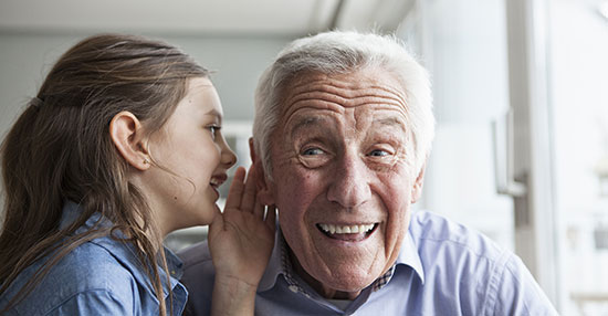 Male resident with niece engaging in playful conversation