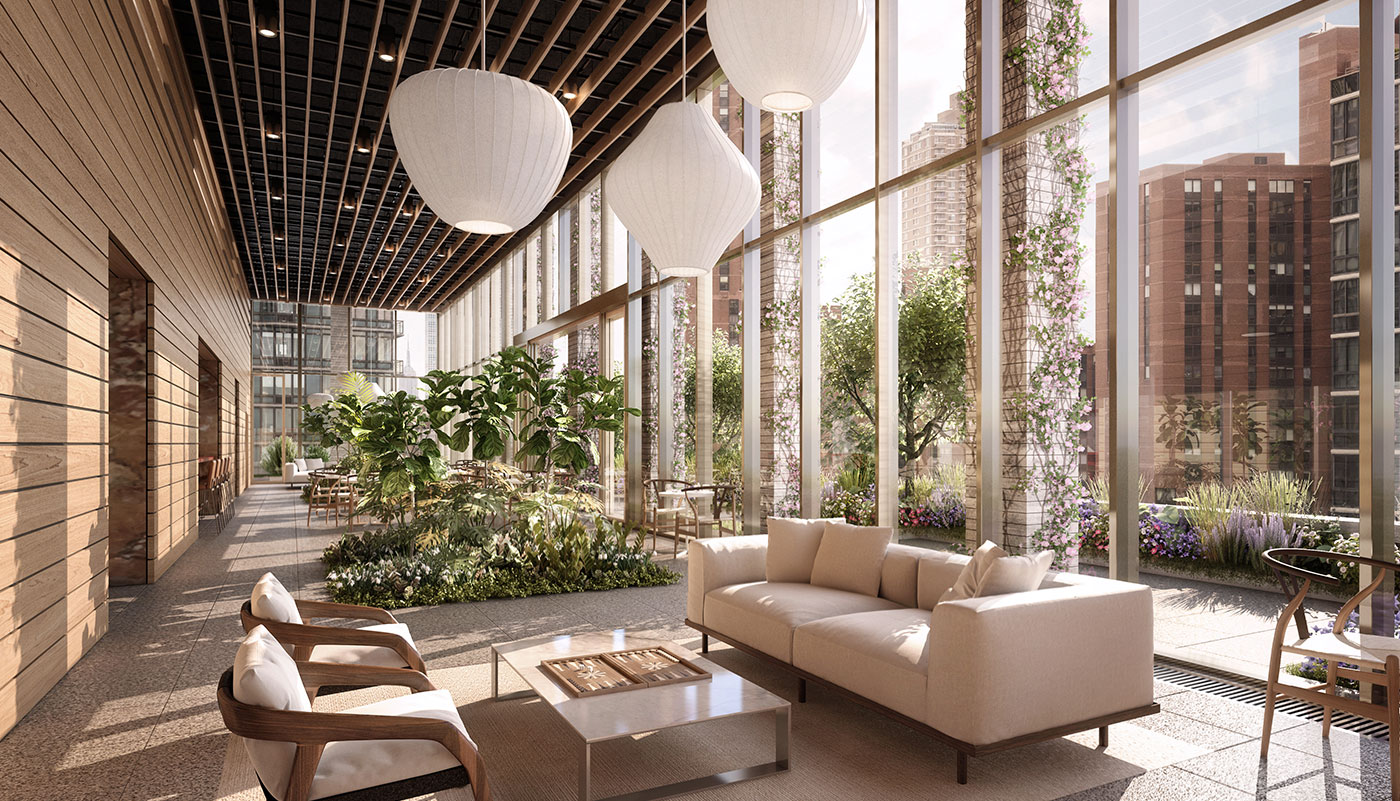 Interior view of Inspires sky park with large white lighting fixtures and plants built into floor