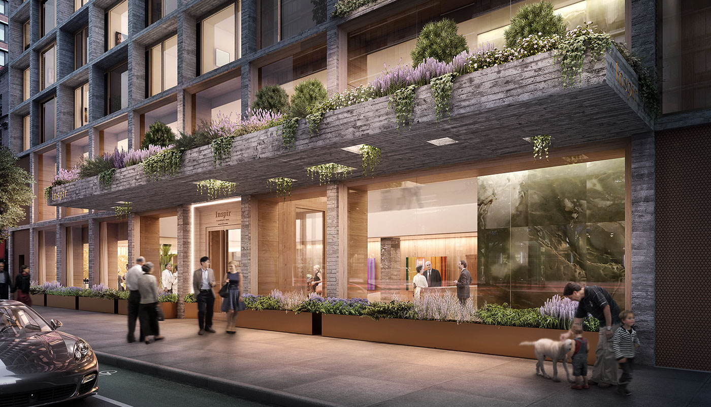 Exterior image of Inspire's main entrance with large garden element above