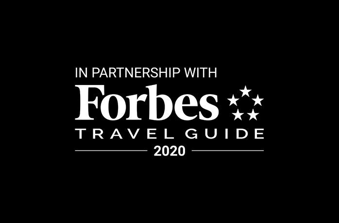logo for forbes travel guide