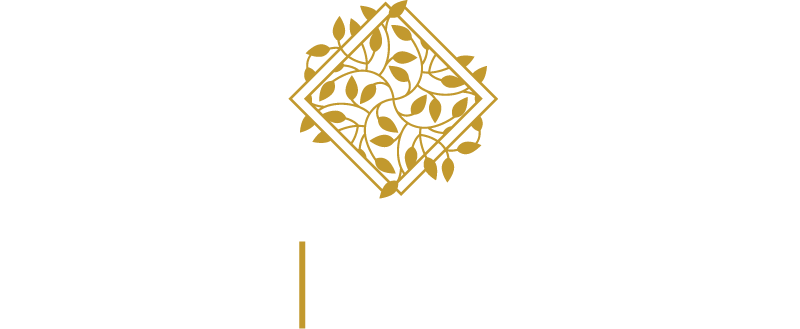 Gold, diamond-shaped, vine-covered Inspire logo with trademark