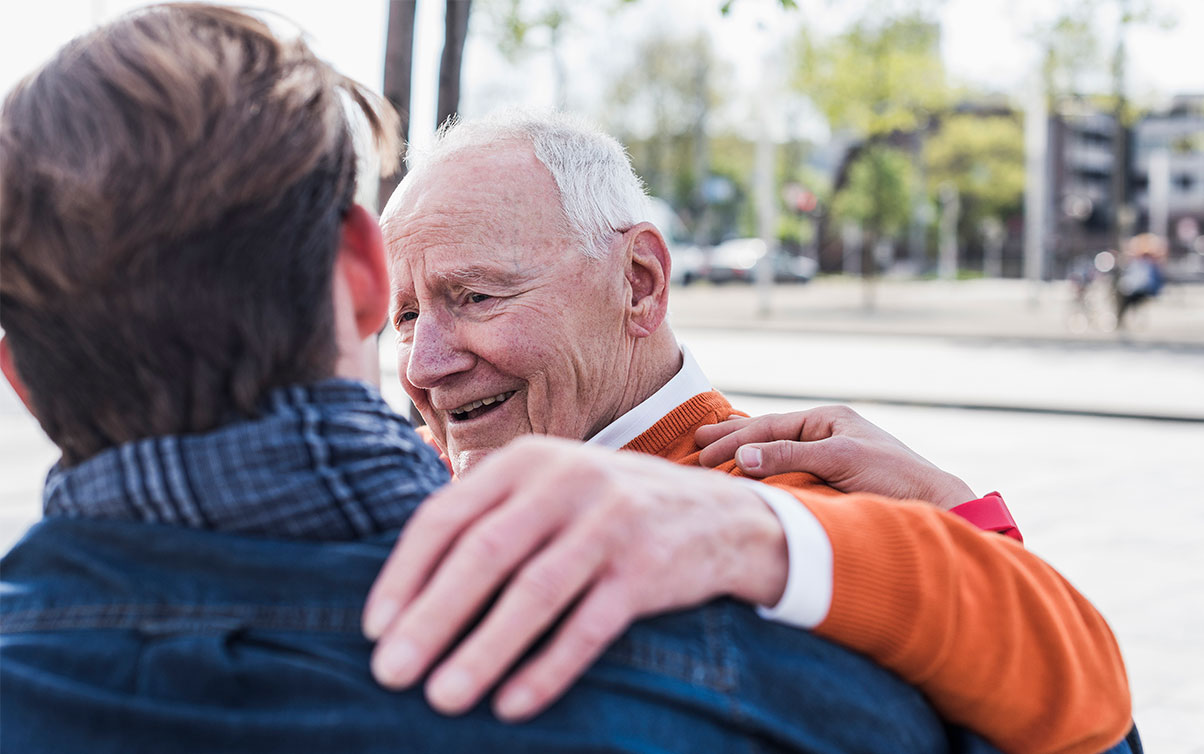 Male resident and son embracing, showing that family is a part of Inspire's Nine Core Elements