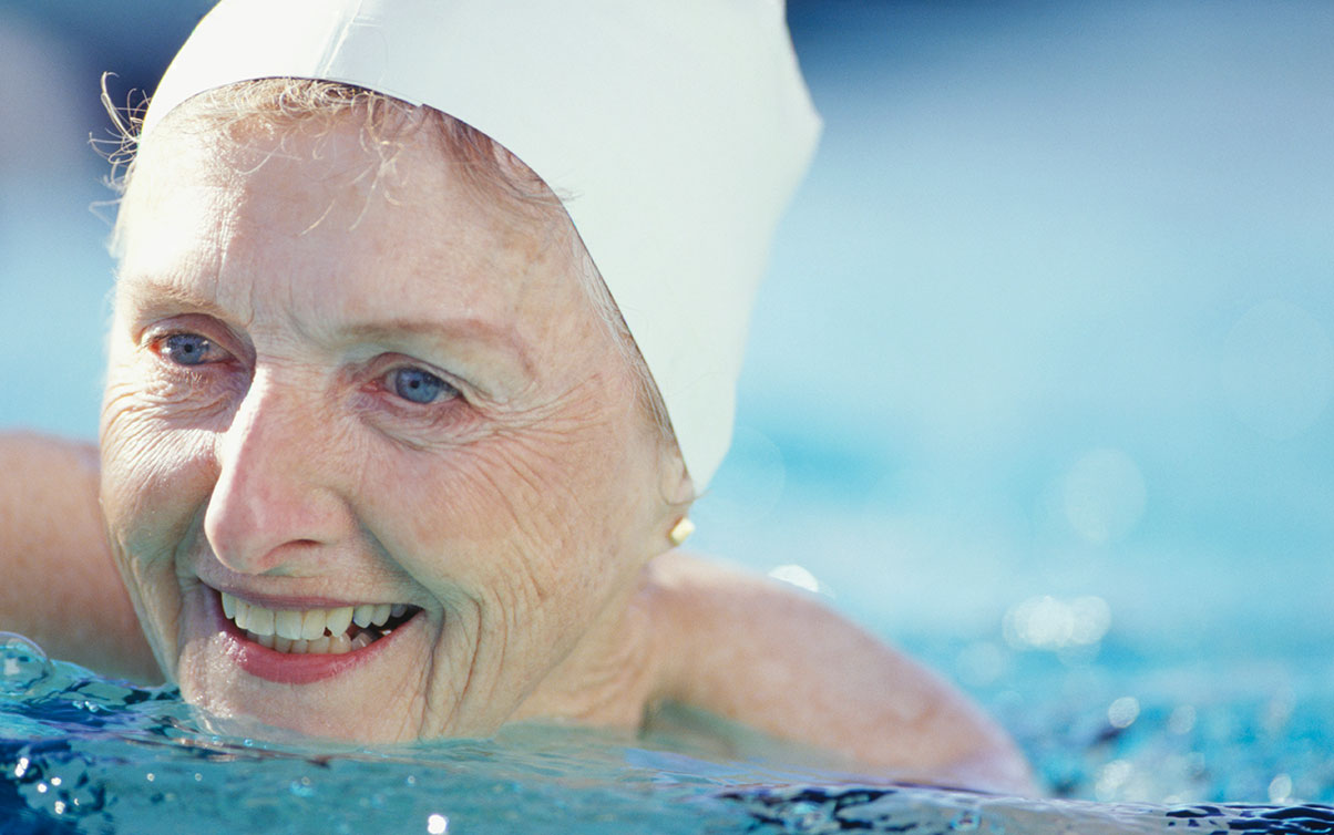 Female resident enjoying a swim in the pool, showing that movement and mobility is a part of Inspire's Nine Core Elements